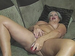 Granny April undresses and savorily jerks off her old cunt fingering spankwire mature